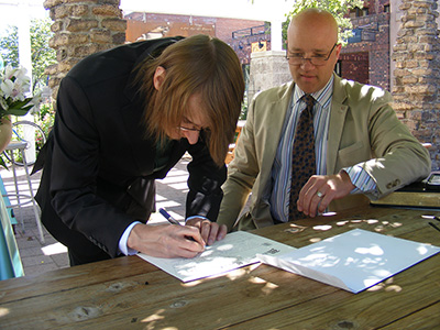 Sweetie signing the marriage certificate
