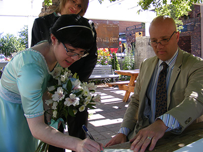 TK signing the marriage certificate
